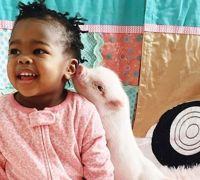 This Friendship Between a Toddler And Her Piglet is Almost Too Adorable to Handle